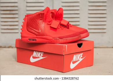 New beautiful colorful and nice Nike Air Max running shoes, sneakers, trainers shows a brand logo on abstract background. Sport and casual footwear concept. Kyiv, Ukraine-APR 08, 2019