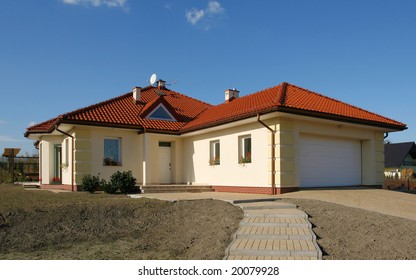 New beautiful house with red roof and garage.