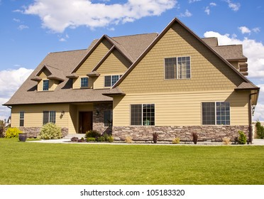 new beautiful suburban luxury house at sunny day with green grass