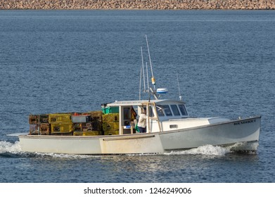 New Bedford, MA, USA - August 27, 2018: Lobsterboat Roundabout, hailing port Mattapoisett, Massachusetts, approaching New Bedford with load of traps