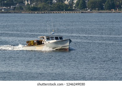 New Bedford, MA, USA - August 27, 2018: Lobsterboat Roundabout, hailing port Mattapoisett, Massachusetts, crossing New Bedford outer harbor with load of traps