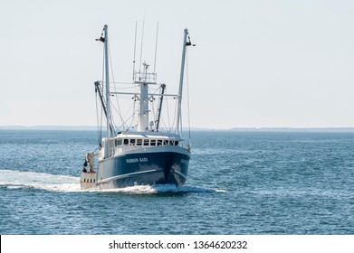 New Bedford, Massachusetts, USA - April 7, 2019:  Commercial fishing boat Madison Kate  returning to New Bedford on morning in early spring