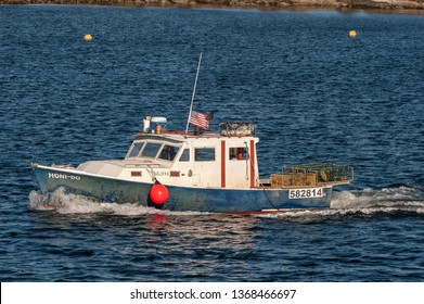 New Bedford, Massachusetts, USA - April 11, 2019: Commercial fishing vessel Honi-Do leaving New Bedford on early spring fishing trip