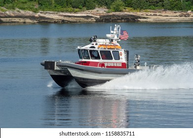 New Bedford, Massachusetts, USA - August 17, 2018: New Bedford Fire Rescue patrol boat speeding past Palmer Island on its way out of New Bedford harbor