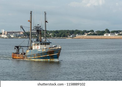 New Bedford, Massachusetts, USA - August 15, 2018: Commercial fishing vessel Capt. Bob, hailing port Cape May, New Jersey, approaching New Bedford