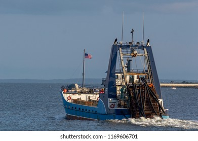 New Bedford, Massachusetts, USA - August 31, 2018: Clammer Sea Watcher II in New Bedford outer harbor, heading into Buzzards Bay in early evening