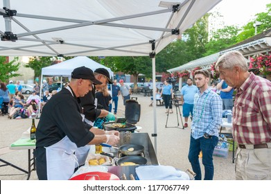 New Bedford, Massachusetts, USA - August 23, 2018: Chefs Michael Comire (l.) and Chris Simonsen of University of Rhode Island preparing their meal  during the 2018 New Bedford Seafood Throwdown