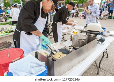 New Bedford, Massachusetts, USA - August 23, 2018: Chef Chris Simonsen of University of Rhode Island Dining Services preparing the polenta during the 2018 New Bedford Seafood Throwdown
