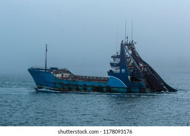New Bedford, Massachusetts, USA, - August 23, 2018: Commercial fishing vessel Sea Watcher I heading out into the fog on Buzzards Bay