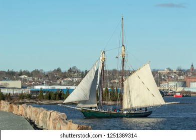 New Bedford, Massachusetts, USA - December 4, 2018: The Lettie G. Howard, a fishing schooner built in 1893 and now a National Historic Landmark, approaching hurricane barrier in New Bedford