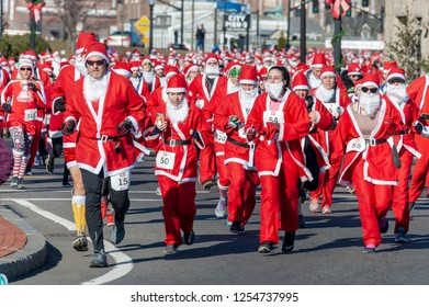 New Bedford, Massachusetts, USA - December 8, 2018: Santas for as far as the eye can see near the start of the Santa Sightings 5K Fun Run along the New Bedford waterfront