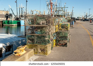 New Bedford, Massachusetts, USA - December 8, 2018: Lobster traps stacked at Leonard's Wharf after season underwater