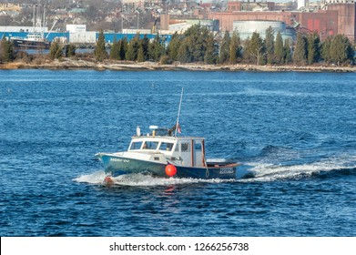 New Bedford, Massachusetts, USA - December 11, 2018: Lobster boat Honi-Do leaving New Bedford with Palmer Island in background