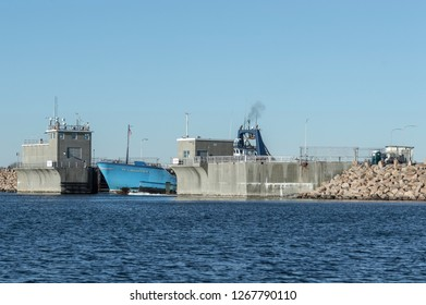 New Bedford, Massachusetts, USA - December 26, 2018: Bow of commercial fishing boat Sea Watcher I emerging from hurricane barrier as vessel heads toward Buzzards Bay