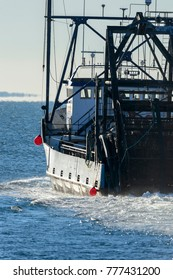 New Bedford, Massachusetts, USA - December 17, 2017: Commercial fishing vessel E.S.S. Pursuit heading into Buzzards Bay from New Bedford