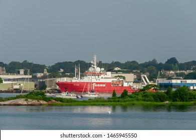 New Bedford, Massachusetts, USA - July 30, 2019: Geotechnical survey vessel Fugro Discovery working her way south along New Bedford waterfront toward Marine Commerce Terminal