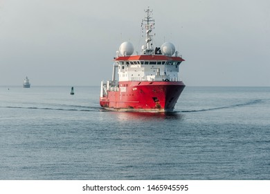 New Bedford, Massachusetts, USA - July 30, 2019: Geotechnical survey vessel Fugro Discovery  nearing New Bedford from foggy Buzzards Bay