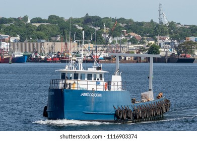 New Bedford, Massachusetts, USA - June 12, 2018: R/V James K Goodwin, hailing port Boston, Massachusetts, crossing New Bedford inner harbor outfitted with new A frame for greater towing capacity