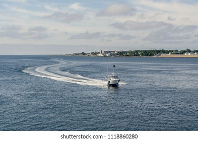 New Bedford, Massachusetts, USA - June 22, 2018: R/V Buzzards Baykeeper water quality monitoring vessel on Acushnet River with New Bedford in background