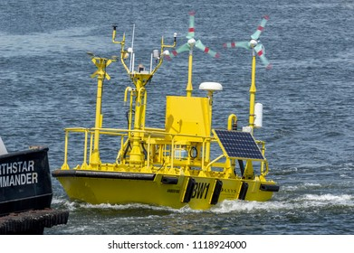New Bedford, Massachusetts, USA - June 22, 2018: Work boat Northstar Commander towing Axys Technologies' FLiDAR WindSentinel wind speed and wind direction monitoring system out of New Bedford harbor