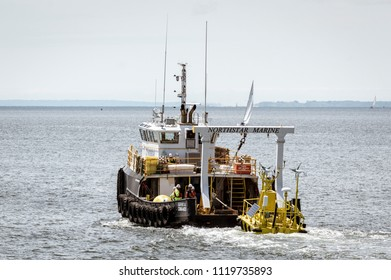 New Bedford, Massachusetts, USA - June 22, 2018: Work boat Northstar Commander towing Axys Technologies' FLiDAR WindSentinel wind speed and wind direction monitoring system toward Buzzards Bay