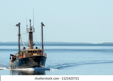 New Bedford, Massachusetts, USA - June 26, 2018: Commercial fishing vessel Morue returning to New Bedford with Elizabeth Islands in background