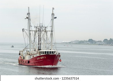 New Bedford, Massachusetts, USA - June 2, 2018: Commercial fishing vessel Lucky Danny II heading for New Bedford from Buzzards Bay on foggy morning
