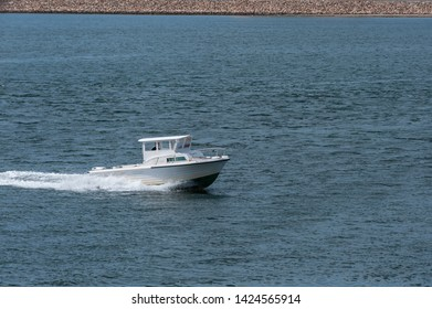 New Bedford, Massachusetts, USA - June 14, 2019: Small cabin cruiser heading into New Bedford