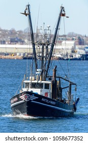 New Bedford, Massachusetts, USA - March 31, 2018: Fishing vessel Mattie and Maren, hailing port Point Judith, Rhode Island, leaving New Bedford harbor