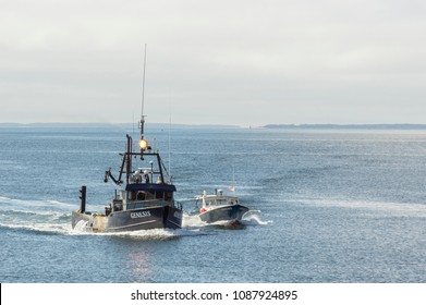 New Bedford, Massachusetts, USA - May 10, 2018: Fishing vessels Genesis and Honi-Do approaching New Bedford harbor with Elizabeth Islands in background