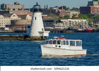 New Bedford, Massachusetts, USA - May 21, 2018: Water taxi Seahorse passing Palmer Island Light Station heading for Cuttyhunk