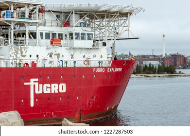 New Bedford, Massachusetts, USA - May 10, 2018: Geotechnical drilling ship Fugro Explorer transiting New Bedford hurricane barrier from Buzzards Bay. Helicopter landing pad can be seen above bridge.