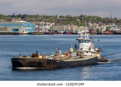 New Bedford, Massachusetts, USA - May 10, 2018: Tug Sirius pushing double-hulled tank barge Meropa 900 across New Bedford harbor