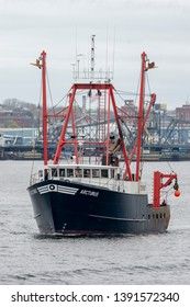 New Bedford, Massachusetts, USA - May 2, 2019: Commercial fishing vessel Arcturus heading down the Acushnet River to go fishing