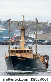 New Bedford, Massachusetts, USA - May 2, 2019: Commercial fishing vessel Morue heading out on fishing trip