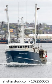 New Bedford, Massachusetts, USA - May 2, 2019: Scalloper Madison Kate crossing New Bedford's inner harbor on its way fishing