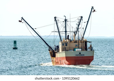 New Bedford, Massachusetts, USA - May 8, 2019: Eastern rig fishing vessel Explorer beginning to lower her outriggers on her way out of New Bedford