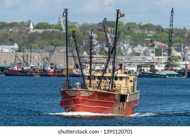 New Bedford, Massachusetts, USA - May 8, 2019: Eastern rig Explorer under way with New Bedford waterfront in background