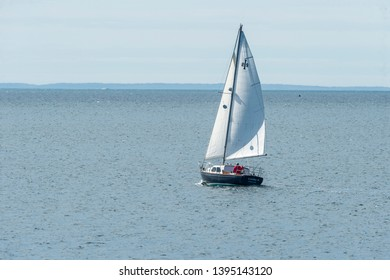 New Bedford, Massachusetts, USA - May 8, 2019: Sailboat Laura P. under sail and heading south toward Buzzards Bay from New Bedford