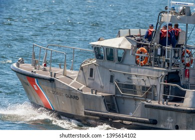 New Bedford, Massachusetts, USA - May 8, 2019: U.S. Coast Guard 47-foot motor lifeboat Menemsha on the way to Buzzards Bay after transiting hurricane barrier