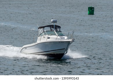 New Bedford, Massachusetts, USA - May 8, 2019: Powerboat cruising across New Bedford outer harbor