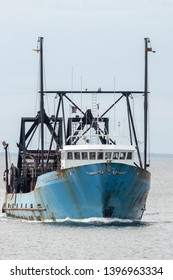 New Bedford, Massachusetts, USA - May 8, 2019: Commercial fishing vessel E.S.S. Pride returning to New Bedford from trip