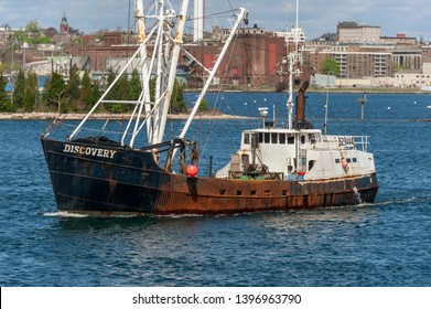 New Bedford, Massachusetts, USA - May 8, 2019: Eastern-rigged commercial fishing vessel Discovery heading out to sea