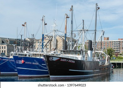New Bedford, Massachusetts, USA - May 11, 2019: Commercial fishing boats Santa Isabel, Santa Maria and Lady of Fatima docked in New Bedford