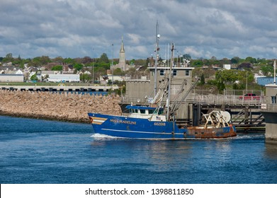 New Bedford, Massachusetts, USA - May 15, 2019: Commercial fishing vessel Miss Madeline, hailing port Cape May New Jersey, transiting New Bedford hurricane protection barrier