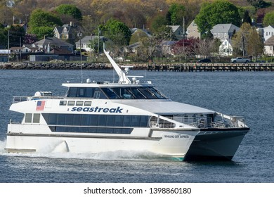 New Bedford, Massachusetts, USA - May 15, 2019: Whaling City Express cruising across New Bedford outer harbor