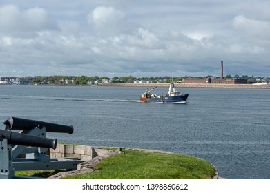 New Bedford, Massachusetts, USA - May 15, 2019: Commercial fishing vessel Nobska crossing New Bedford outer harbor under cloudy skies