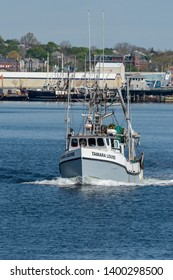 New Bedford, Massachusetts, USA - May 16, 2019: Commercial fishing vessel Tamara Louise, hailing port Montauk, New York, heading out to sea from New Bedford