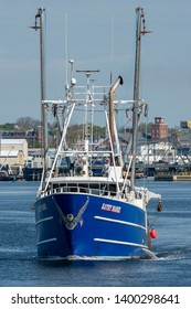 New Bedford, Massachusetts, USA - May 16, 2019: Scalloper Kathy Marie heading out to sea from New Bedford