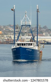 New Bedford, Massachusetts, USA -  November 1, 2017: Commercial fishing vessel K.A.T.E. II leaves New Bedford against waterfront background